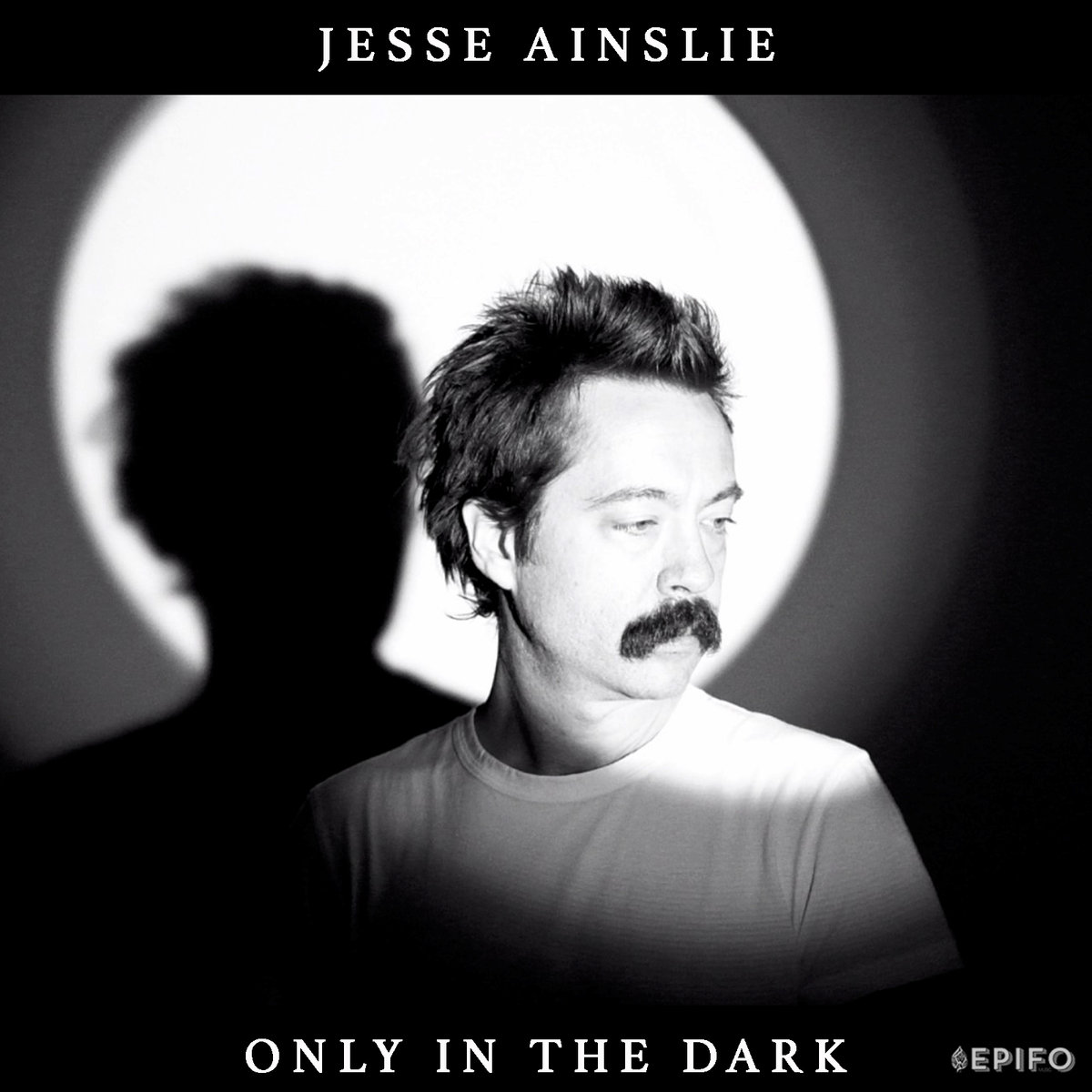 "Poignant, Biting, Vulnerable, Resilient, and Tuneful as F*** – Jesse Ainslie's Full-Length Debut ""Only in the Dark"""